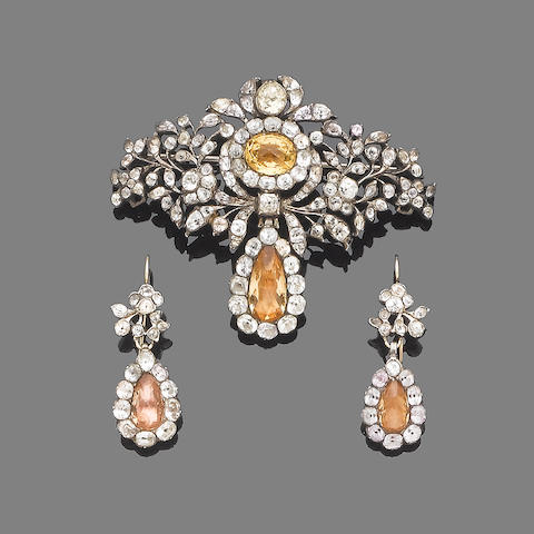 An 18th century topaz and paste brooch and a pair of earring (2)