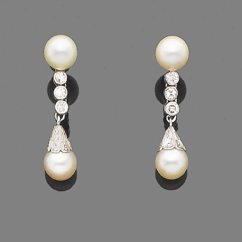 A pair of cultured pearl and diamond pendent earrings