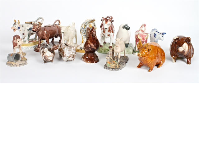 A small group of pottery cow creamers
