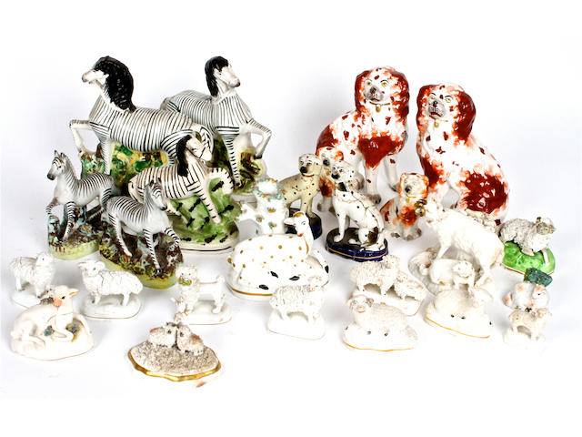 A small group of Staffordshire pottery animals