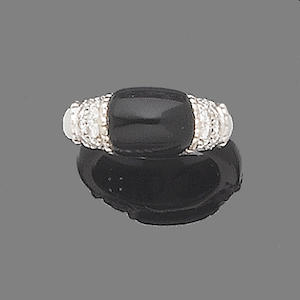 An onyx and diamond dress ring, by Kutchinsky,