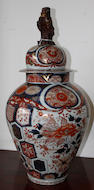 A pair of Japanese Imari vases and covers with kylin finials, 19th century
