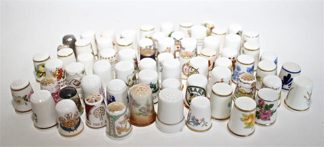 A small group of English porcelain mugs, thimbles and cups and saucers