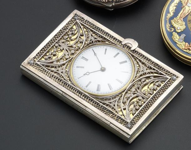 Swiss. A key wound silver filigree book watchCirca 1860