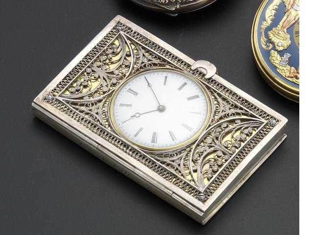 Swiss. A key wound silver filigree book watch Circa 1860