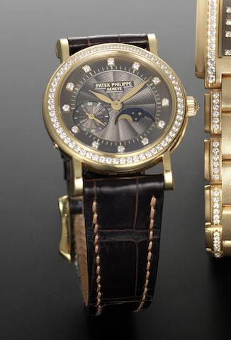 Patek Philippe. A lady's 18ct and diamond set manual wind wristwatch with moonphase Ref. 4958/1J, Movement number 3115617, recent