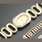Ebel. A lady's 18ct gold and diamond set manual wind bracelet watch with case made by Boucheron Circa 1980