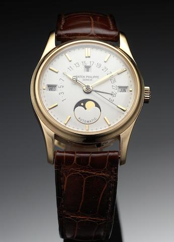 Patek Philippe. A fine and rare rose gold perpetual calendar wristwatch with retrograde date and phases of moon together with fitted Patek Philippe wooden box Ref:5050, Case No.2980976, Movement No.1957499, circa 1994