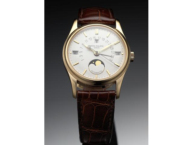 Patek Philippe. A fine and rare rose gold perpetual calendar wristwatch with retrograde date and phases of moon together with fitted Patek Philippe wooden boxRef:5050, Case No.2980976, Movement No.1957499, circa 1994
