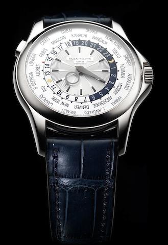 Patek Philippe. A very fine automatic white gold wristwatch together with Certificate of OriginWorld Time, Ref:5130G, Case No.4484037, Movement No.3940189, Retailed by Haban of Vienna, recent