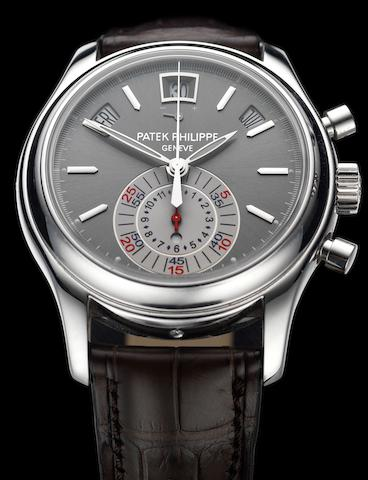 Patek Philippe. A fine and rare platinum automatic flyback chronograph annual calendar wristwatch with power reserve and day/night indication, together with fitted presentation box, Certificate of Origin and setting toolRef:5960P, Case No.4435376, Movement No.3503607, Movement No. 3503607, Sold 28th November 2008