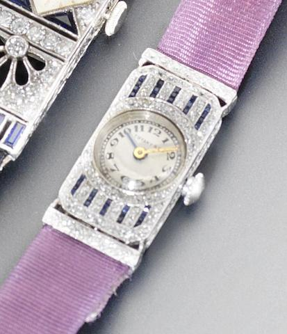 Swiss. A lady's platinum and diamond and sapphire set wristwatch Retailed by Tiffany and Co, 1920's