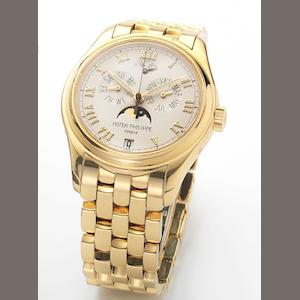 Patek Philippe. A fine 18ct gold astronomic centre-seconds automatic wristwatch with annual calendar moon phases and 48-hour power reserve together with Patek Philippe box and papers Ref:5036/1, Case No.4230103, Movement No.3287782, Sold 7th January 2006