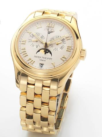 Patek Philippe. A fine 18ct gold astronomic centre-seconds automatic wristwatch with annual calendar moon phases and 48-hour power reserve together with Patek Philippe box and papersRef:5036/1, Case No.4230103, Movement No.3287782, Sold 7th January 2006