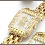 Patek Philippe. A fine lady's 18ct gold and diamond set quartz bracelet watch Recent