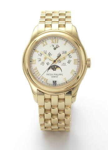 Patek Philippe. A fine 18ct gold astronomic centre-seconds automatic wristwatch with annual calendar moon phases and 48-hour power reserve together with Patek Philippe box and setting toolRef:5036/1, Case No.4108256, Movement No.3145366, recent