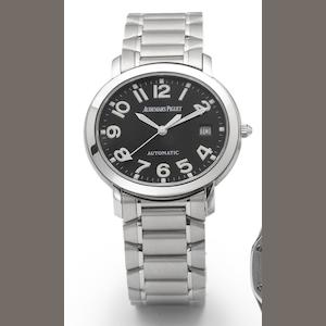 Audemars Piguet. A stainless steel automatic centre seconds calendar bracelet watch together with fitted box Recent