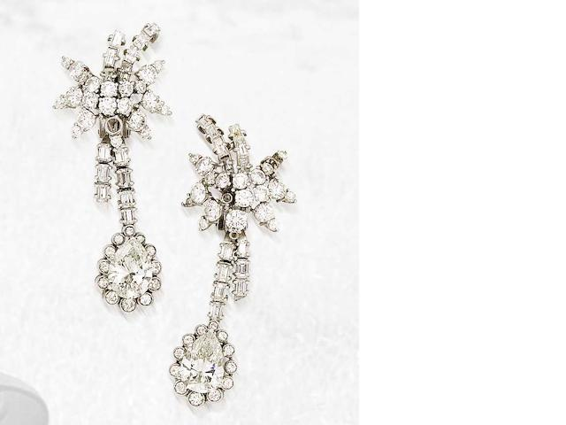A pair of diamond pendent earrings, by Sanz,