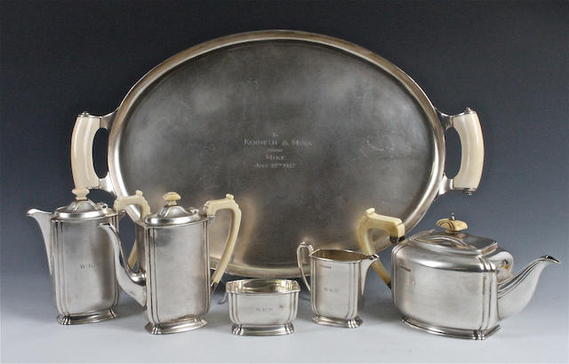 A silver five piece tea and coffee set with matched tray The tea set with maker's mark 'FC', Sheffield, 1935, the tray by Asprey and Co, London, 1936,  (6)