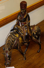 An 18th Century Chinese export painted bronze group of a sage on horseback