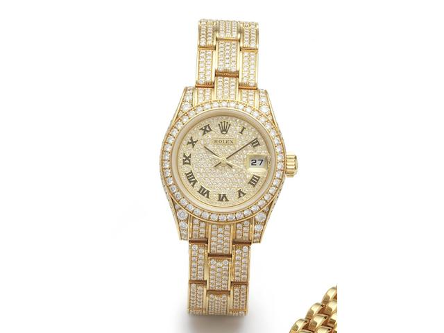 Rolex. A fine 18ct gold and diamond set automatic calendar bracelet watch together with fitted leather Rolex jewellery box and papersDatejust, Ref.179458, Serial No.K566765, Sold Harrods 25th December 2002