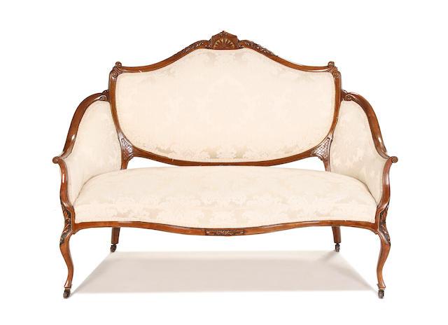 A late Victorian walnut sofa