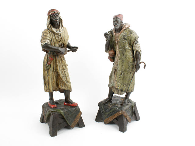 A pair of cold painted figures of Arabs