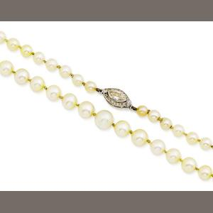 A pearl necklace with diamond clasp,