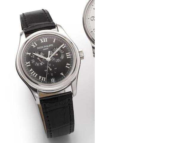 Patek Philippe. A fine 18ct white gold automatic calendar wristwatch together with presentation box and Certificate of Origin Ref.5035G, Case No.4236214, Movement No.3135845, Sold December 2003