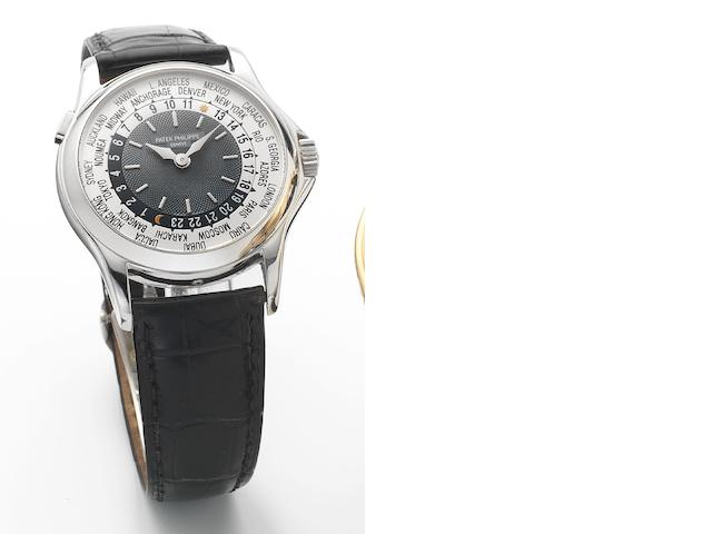 Patek Philippe. A fine platinum automatic world time calendar wristwatch together with presentation box and papersWorld Time, Ref.5110P-001, Case No.3210102, Movement No.4210210, Sold 18th December 2002