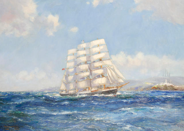 Frank Henry Mason (British, 1875-1965) A four masted sailing ship under full sail off a headland, possibly the 'Pamir'