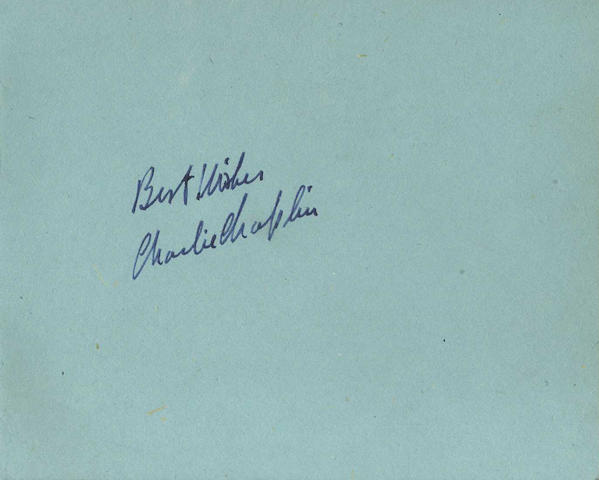 An autograph book signed by Charlie Chaplin, Abbott & Costello and others,