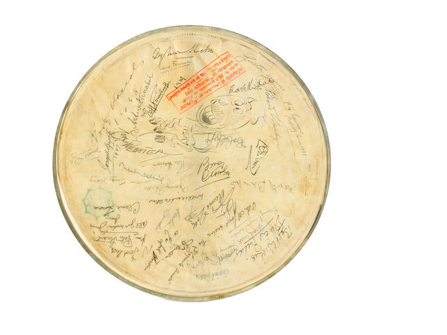 Five drumskins signed by various actors, musicians and others,