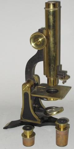 A 19th century mahogany cased lacquered brass monocular microscope by Henry Crouch