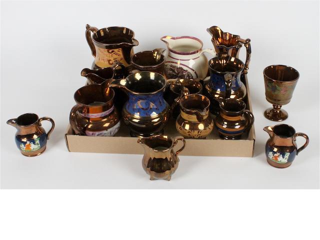 A collection of Victorian copper lustre jugs Circa 1840-1880