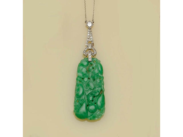A jade and diamond pendant,
