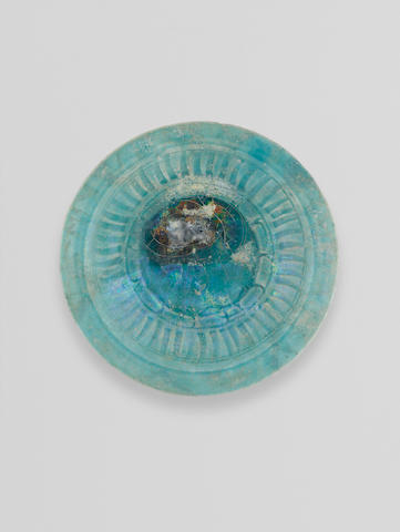 A Kashan monochrome turquoise pottery Dish Persia,  12th/ 13th Century