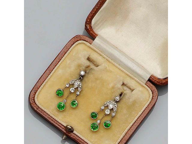 A pair of early 20th century diamond and demantoid garnet earpendants