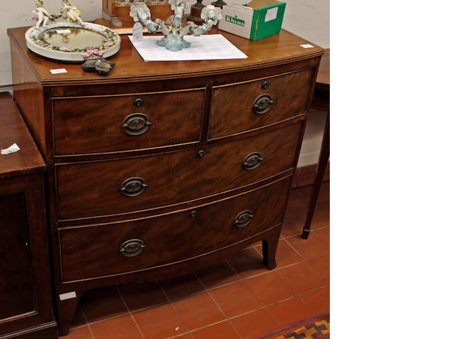 A small mahogany bow fronted chest of drawers,