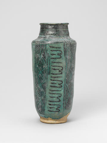 A turquoise pottery jar