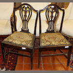 A pair of early 19th century mahogany dining chairs,