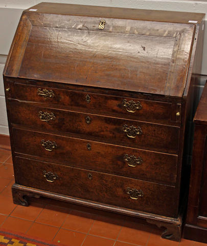 A late George III oak bureau,fitted below the fall front with four long graduated drawers, 95cm wide