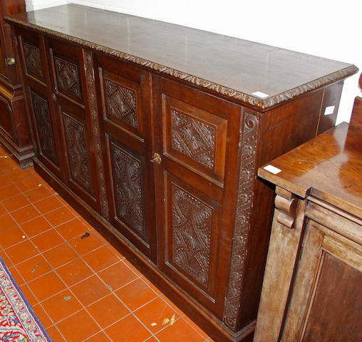 A Victorian oak cupboard,