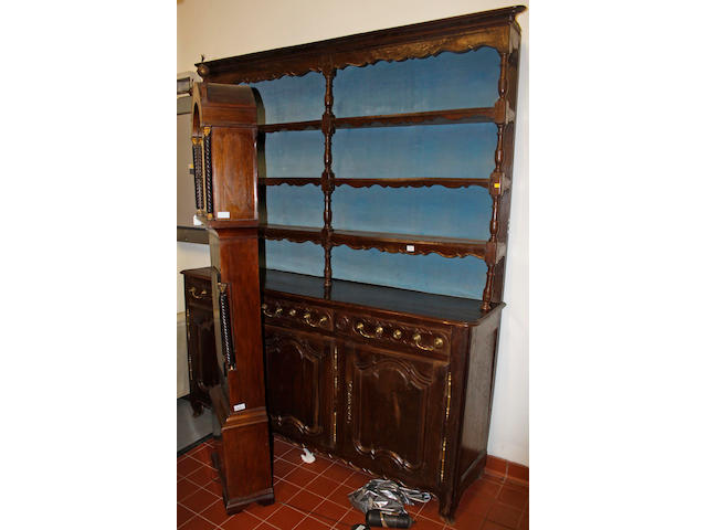 A 19th Century French chestnut farmhouse dresser and rack,with three frieze drawers and cupboards under, 200cm wide x 240cm high