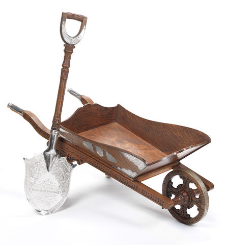 """Of Political and Railway interest; A late Victorian and silver mounted wheel barrow and shovel, by Walker & Hall, Sheffield 1892, incuse stamped """"Manufactured by Walker & Hall silversmiths Sheffield"""""""