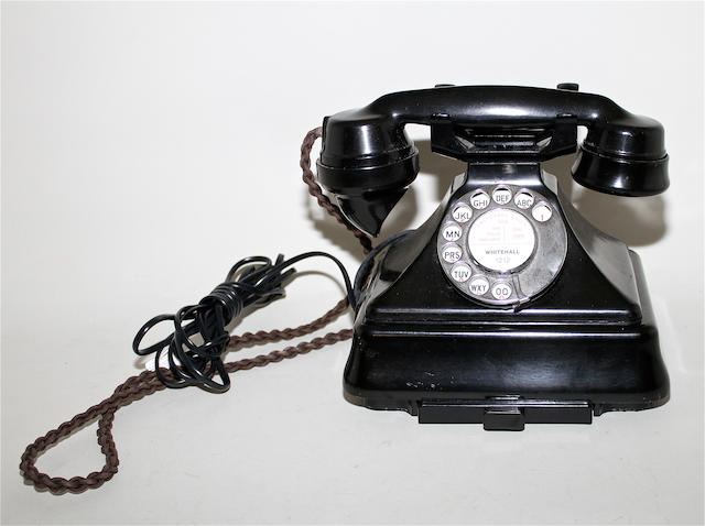 A 200-series black bakelite telephone on bell-box, circa 1952, impressed mark 164/52,