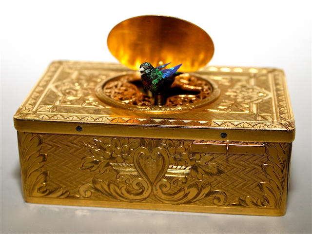 A gilt metal singing bird box