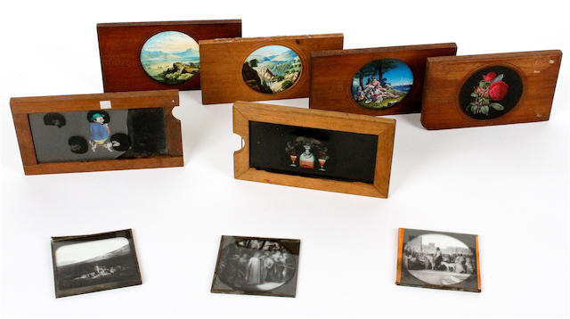 A collection of thirty-one sliding magic lantern slides: mostly humourous, early 20th Century,