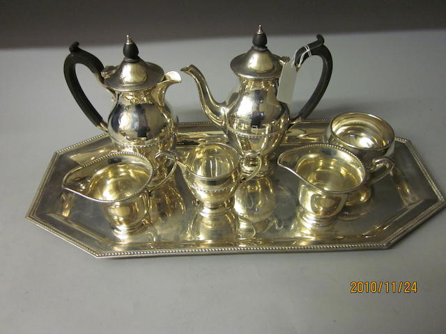 A four piece coffee service, by Elkington and Co.,  Birmingham 1933, 1934,   (7)