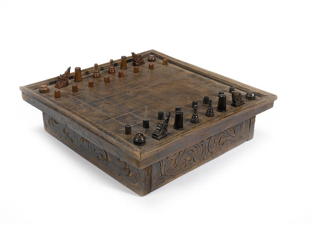 A hardwood and horn Moro chess set and board Moranoa peoples, Phillippines, probably early 20th century